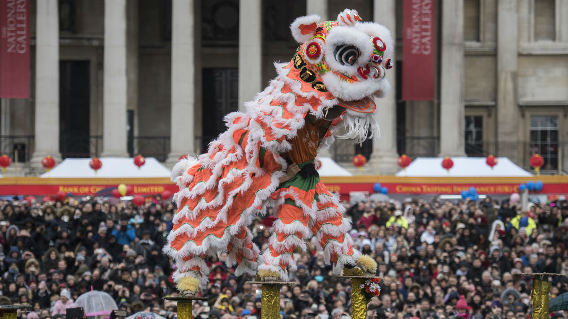 A lion dance takes place among the crowds during Chinese New Year in Trafalgar Square 2017. © Greater London Authority