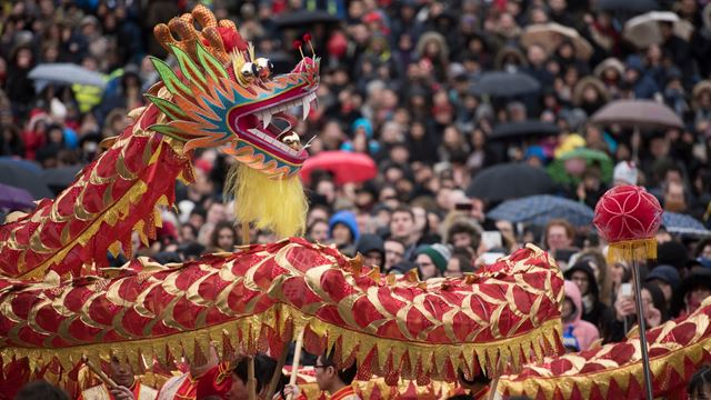 Red dragon dance drawing a crowd during Chinese New Year celebrations in Trafalgar Square.