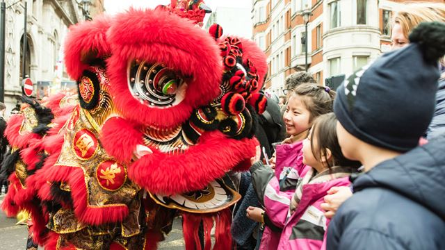 Lion dancers during the Chinese New Year 2017 parade. Photo by: Jon Mo