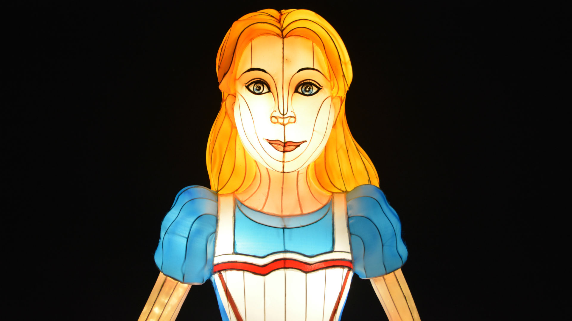 Artistic image of Alice with long blonde hair, blue dress and white apron