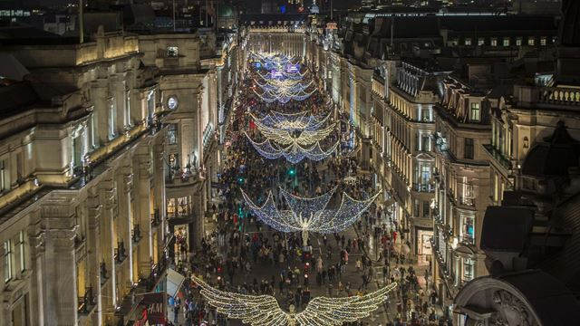 A photo of Regent Street Christmas lights in the evening from above.