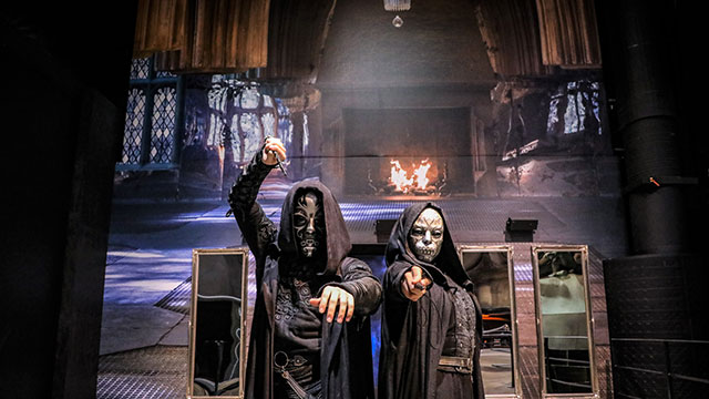 Two Death Eaters duelling in the Great Hall