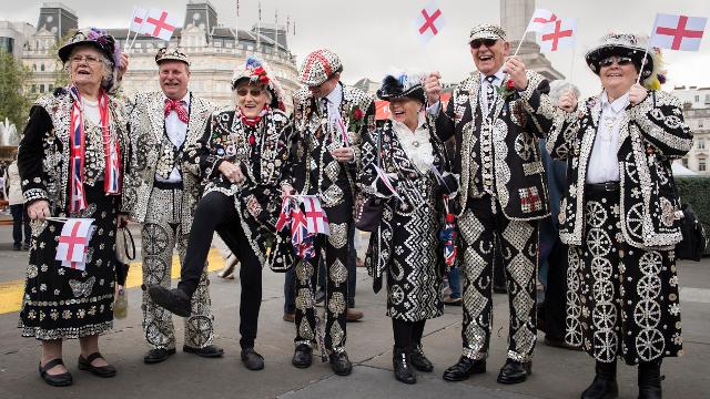 A group of Pearly Kings and Queens celebrating at the Feast of St George.