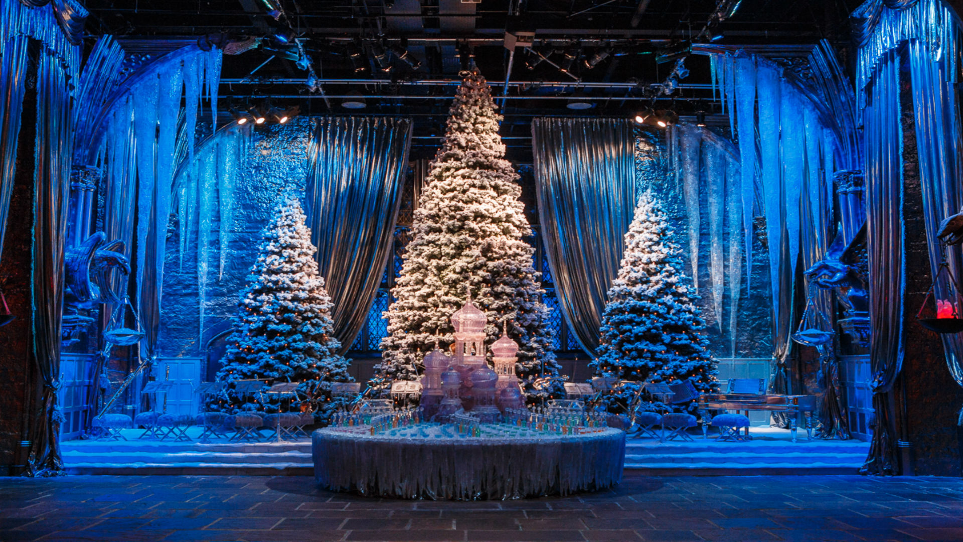 Christmas tree on Great Hall with Yule Ball stage at Hogwarts in the Snow at Warner Bros. Studios the Making of Harry Potter