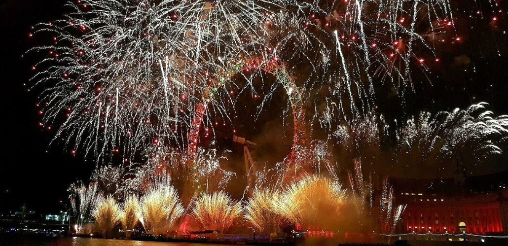Gold and red fireworks around the Coca-Cola London Eye on New Year's Eve.