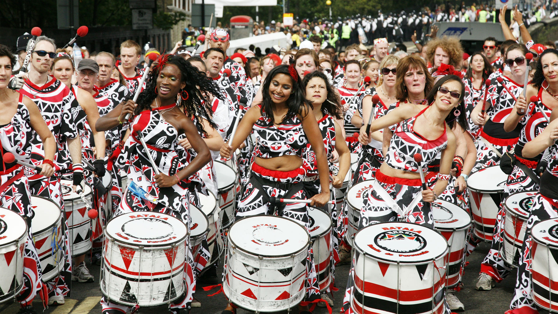 A band of drummers perform during Notting Hill Carnival parade