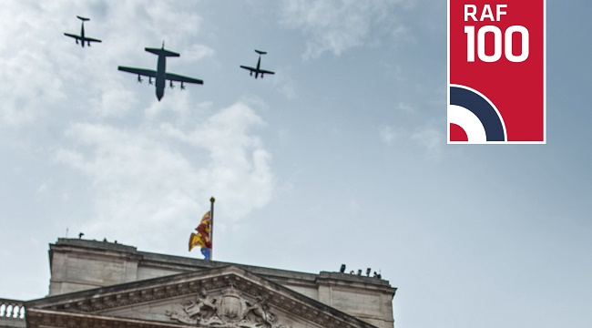 Royal AIrforce Planes fly across a blue sky over Buckingham Palace