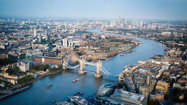 An aerial view of Tower Bridge, the Thames, London Bridge area and the City of London.