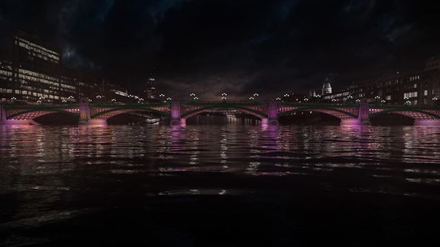 The Illuminated River installation lights up the Thames with purple LED lights reflecting on the water.