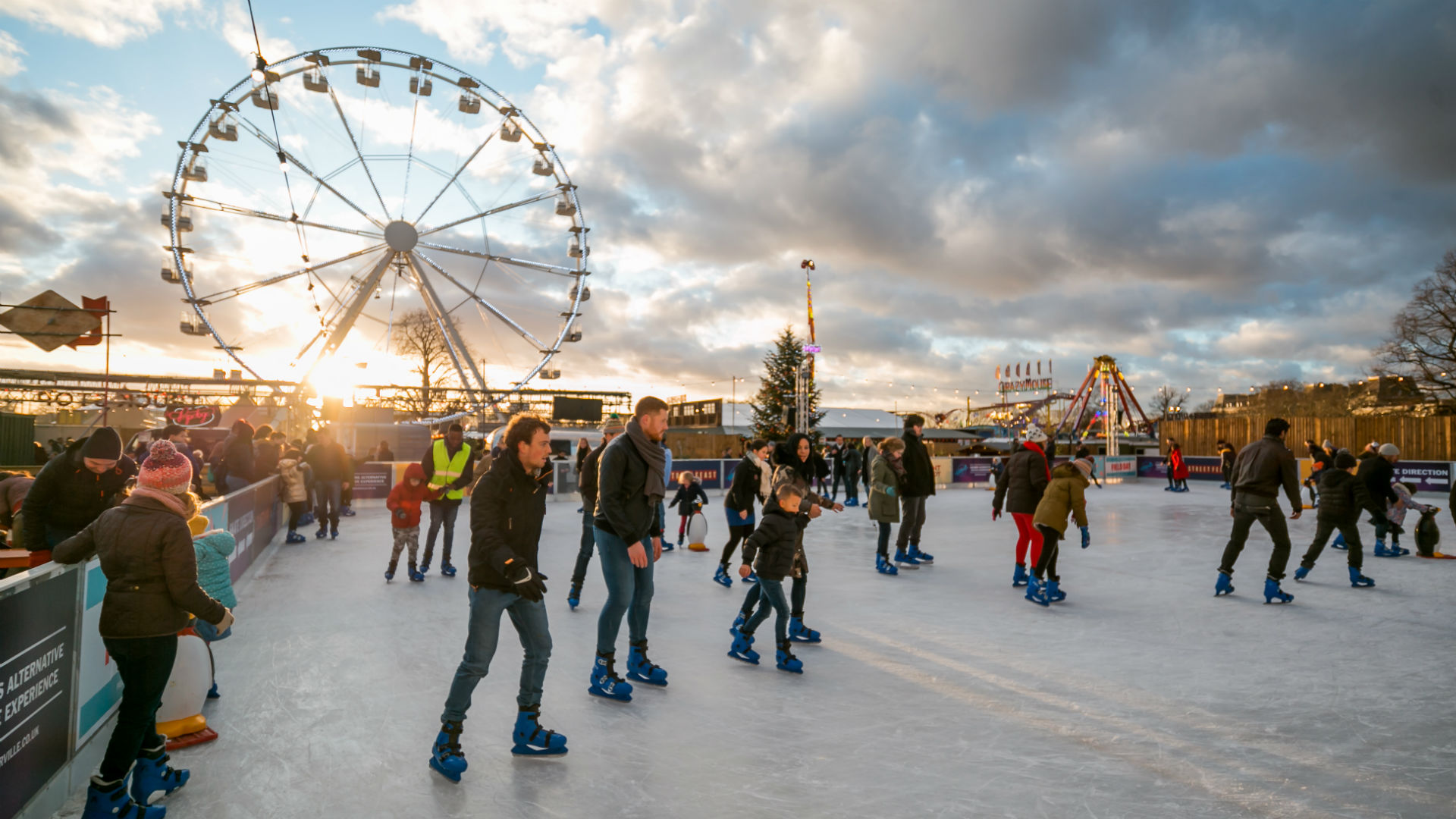 People glide around the ice rink at Winterville