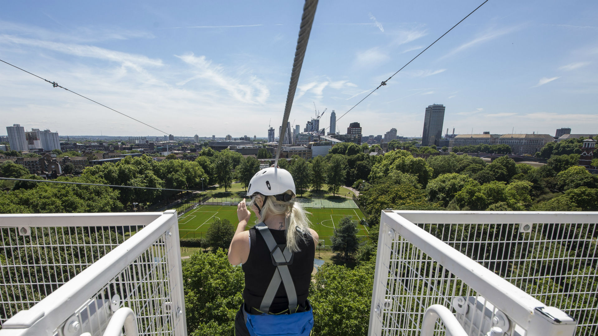 A woman prepares to whizz down one of the zip wires at Zip Now London