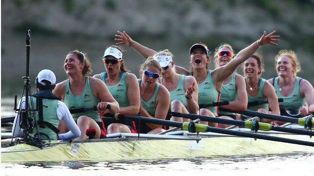 Rowers in rowing boat exulting after victory