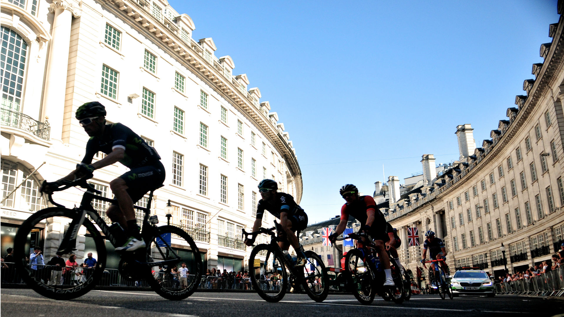Cyclists from the OVO Energy Tour of Britain racing through the streets of London. Image courtesy of Tour of Britain.