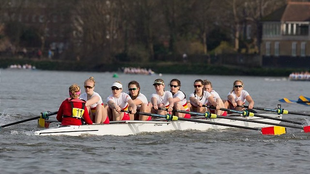 CUS Milano crew row in white boat along the Thames in Women's Eights Head of the River Race