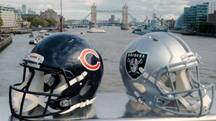Two NFL helmets are pictured on a bridge in London with Tower Bridge visible in the background. Image courtesy of NFL UK.