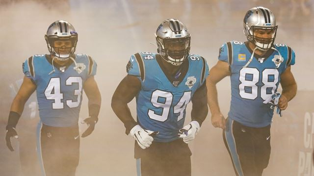 Three Carolina Panther players run onto the field. Image courtesy of NFL UK and Dave Shopland.