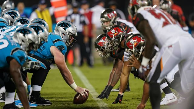 The Carolina Panthers come face to face with the Tampa Bay Buccaneers during an NFL game. Image courtesy of NFL UK and Dave Shopland.