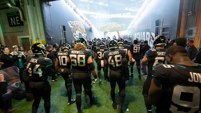 The Jacksonville Jaguars team walk through the tunnel onto the field. Image courtesy of NFL UK.