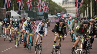 Competitors of the Brompton World Championship Final race down The Mall. Image courtesy of Prudential RideLondon