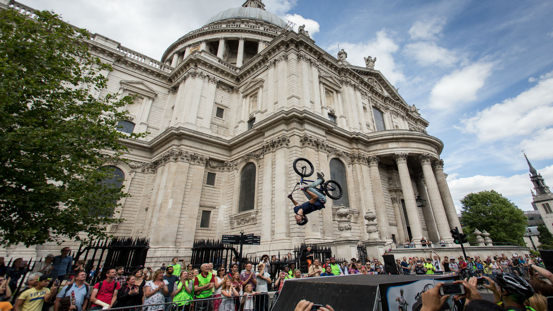 A cyclist does a backflip at the St Pauls Prudential RideLondon Festival Zone. Image courtesy of RideLondon