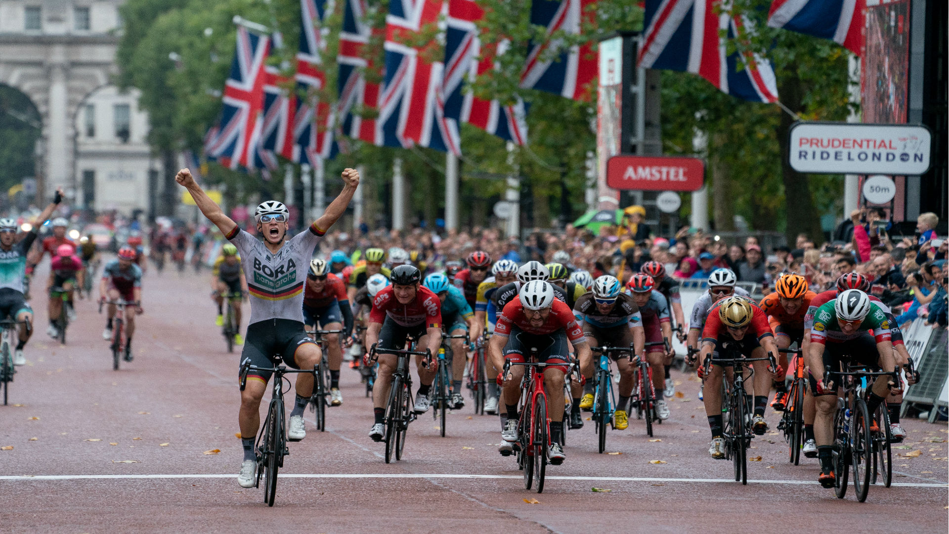 Cyclist celebrating at the Prudential RideLondon Classic. Image courtesy of RideLondon.