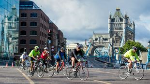 Prudential RideLondon-Surrey 100 riders cross Tower Bridge as they head through London. Image courtesy of Prudential RideLondon