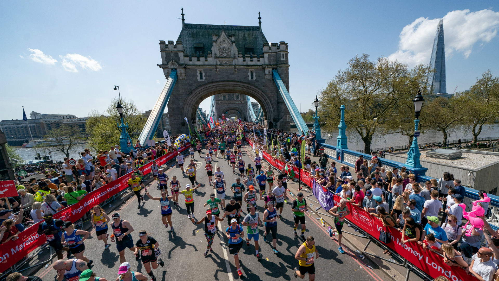 Crowds running over Tower Bridge during the Virgin Money London Marathon