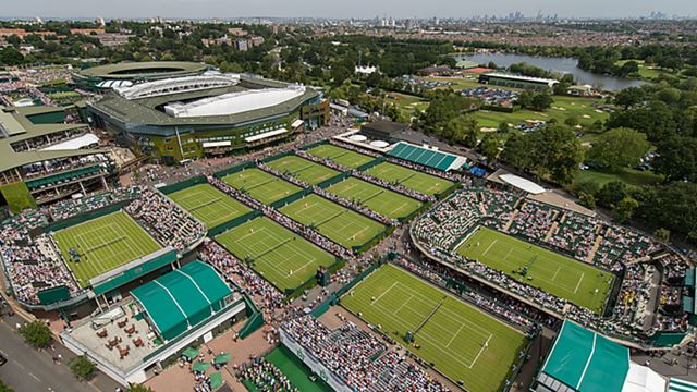 An aerial view of the tennis courts overlooking Wimbledon on day one of The Championships 2015 at The All England Lawn Tennis Club with London's panorama in the background