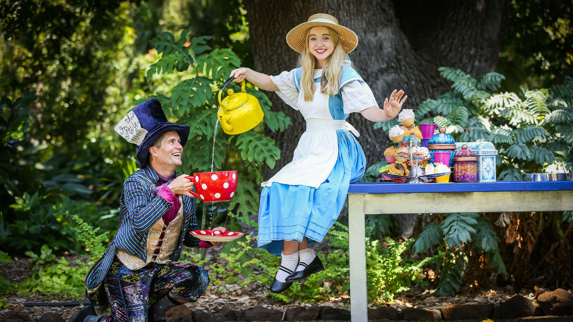 Alice and the Mad Hatter in Alice in Wonderland at Kew Gardens