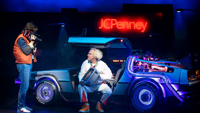 Marty McFly and Doc Brown working on the car to go back to the future