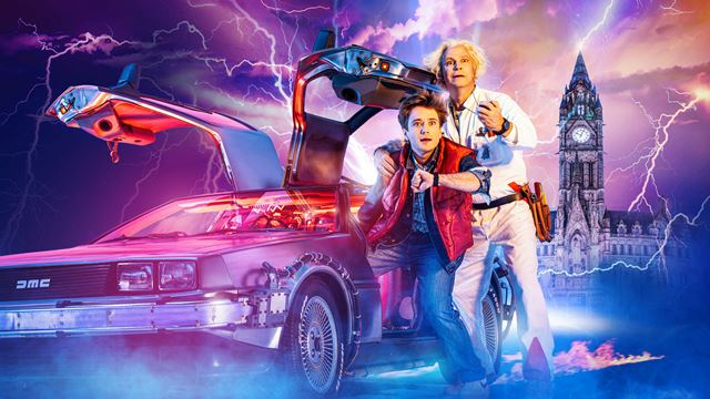 The two main characters stand next to the DeLorean car, with graphics showing Big Ben and lightning in the background.