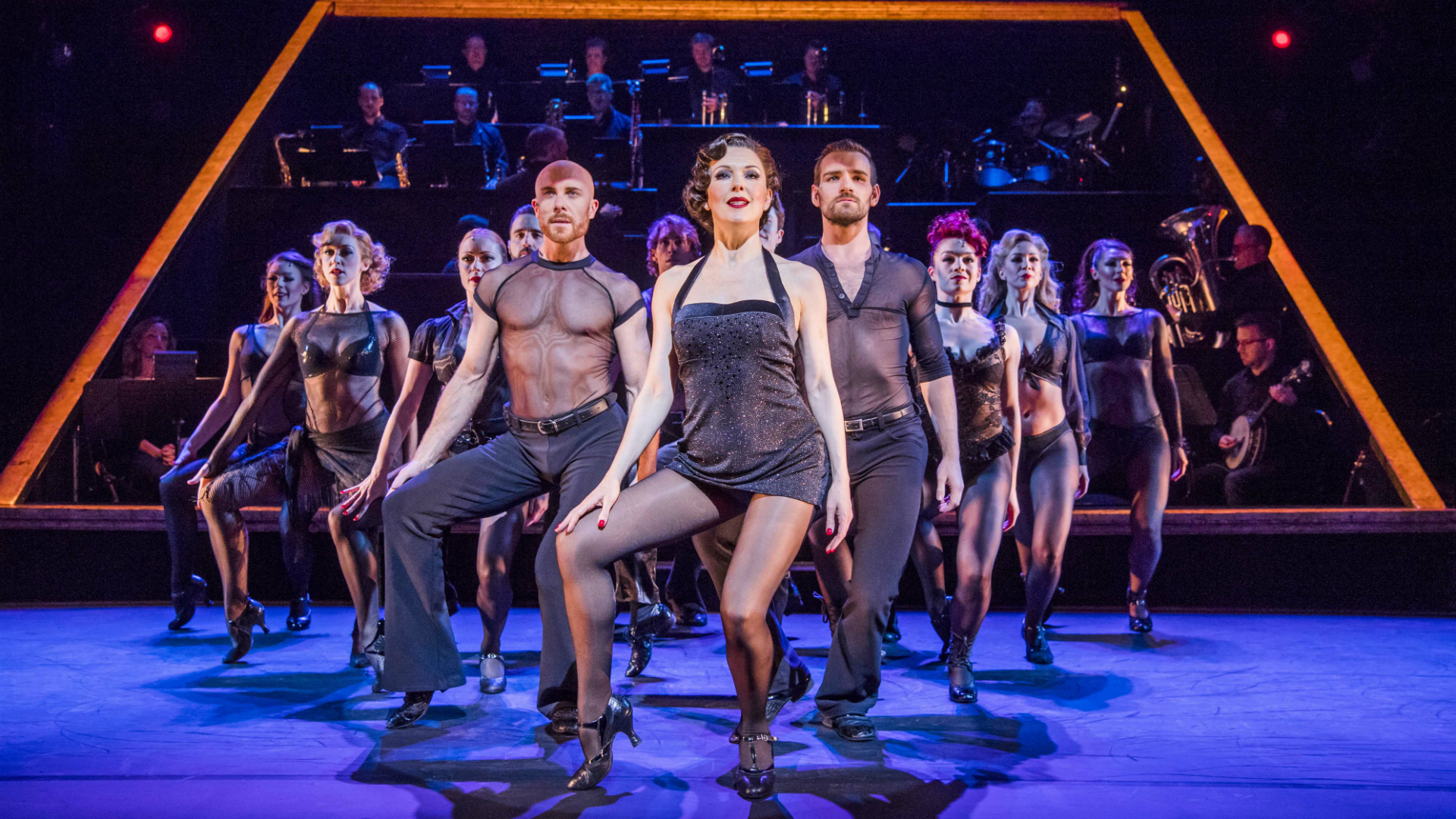 The cast of Chicago dance on stage at the Phoenix Theatre