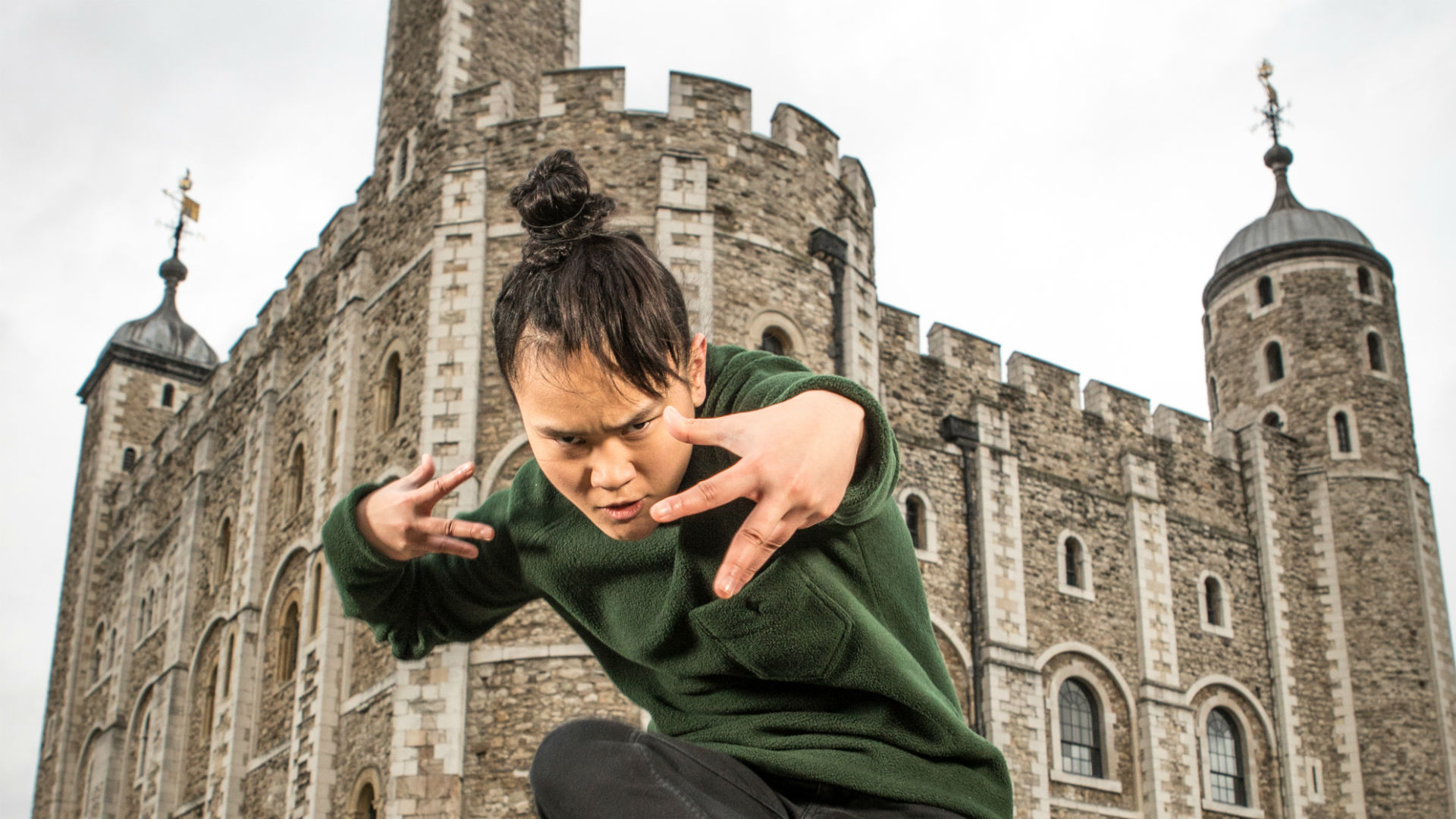 A performer dances outside of the Tower of London