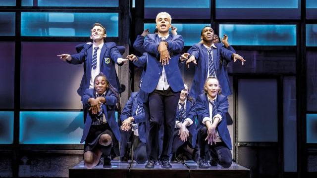 Jamie and his friends dancing in school uniform