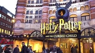 Harry Potter sign at the Palace Theatre with people queuing outside