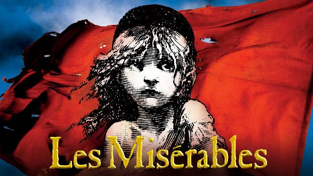 A poster depicting the top half of a young girl in black and white against a red and blue background