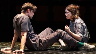 Actors Claire Foy and Matt Smith perform a scene on stage at the Old Vic