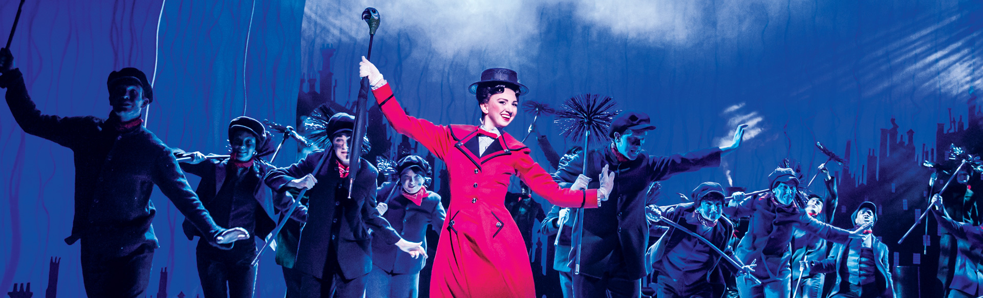 Zizi Strallen as Mary Poppins dancing on stage