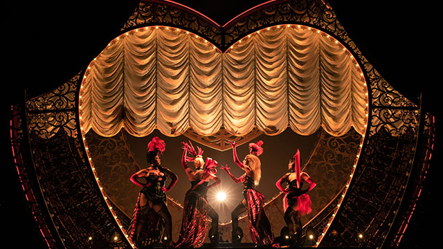 A colourful cabaret on stage at the Moulin Rouge musical