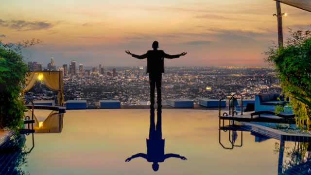 Tartuffe promotion poster - a man overlooking the city.
