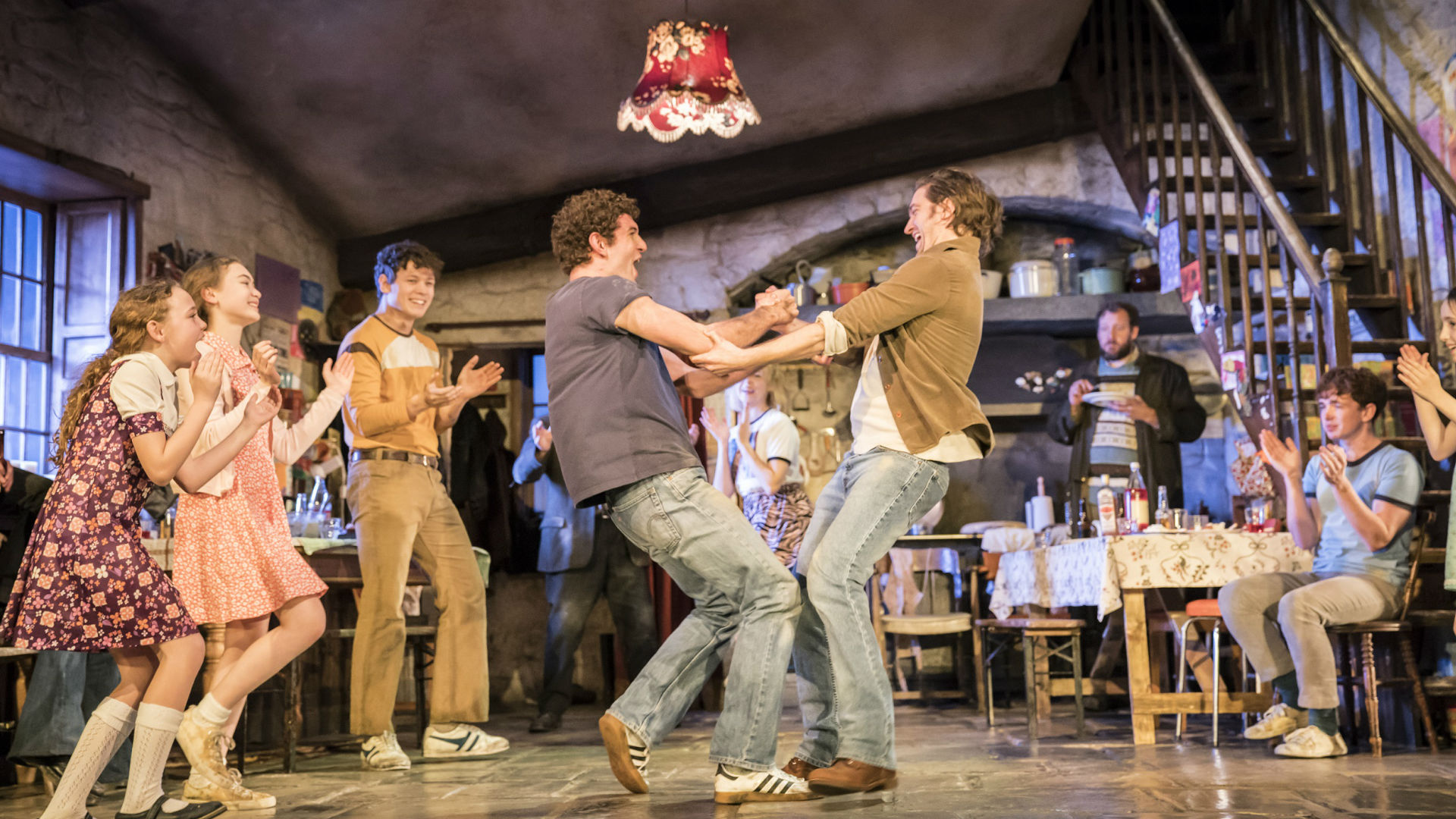 The cast dance on stage during The Ferryman at Gielgud Theatre. Photo credit: Johan Persson. Image courtesy of The Corner Shop PR.