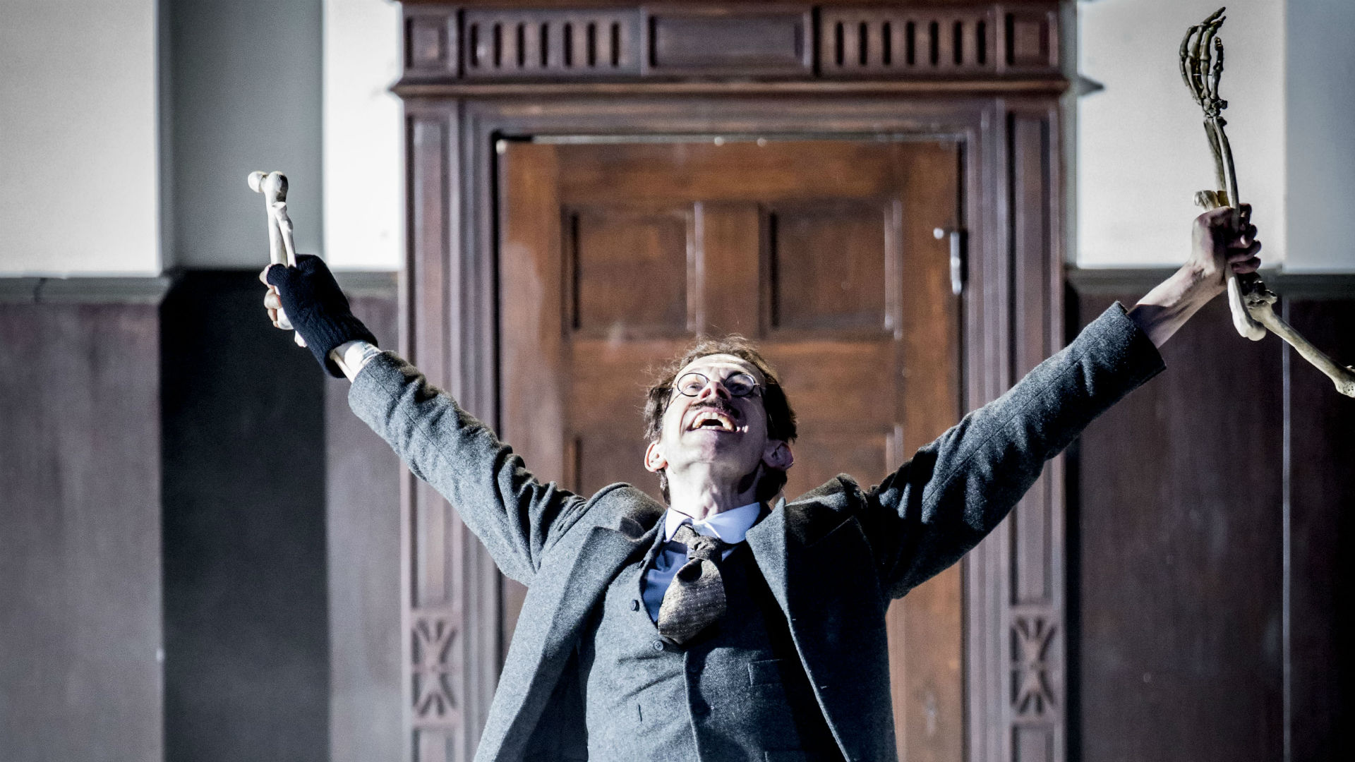 A performer celebrates in The Lehman Trilogy