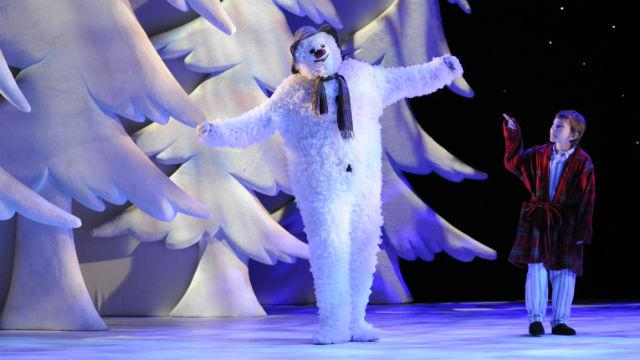 A snowman and a boy in The Snowman at the Peacock Theatre.