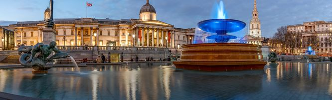 Evening view of Trafalgar Square with the National Gallery. © London and Partners/Jon Reid