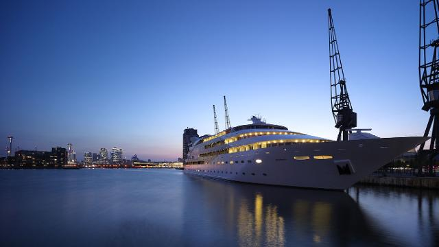 A large yacht, which has been turned into the Sunborn London hotel, taken from the quayside at dusk.