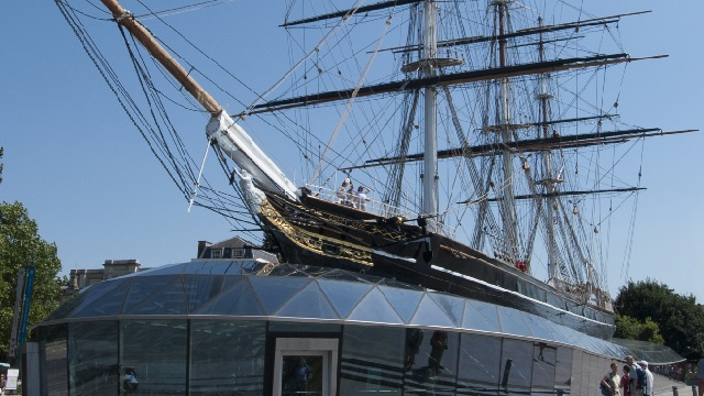 Cutty Sark exterior, with a glass structure surrounding the hull and the original ship on top.