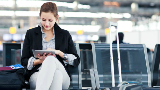 Business Traveller at airport with luggage