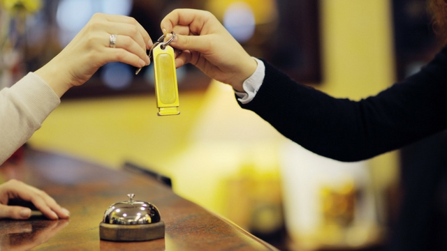 Handing over keys to hotel room
