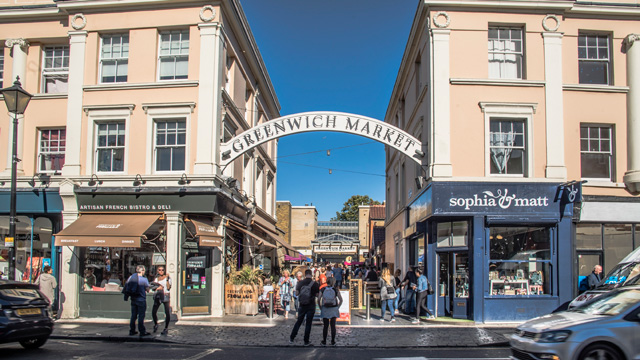 View of Greenwich Market sign and people wandering around the streets of Greenwich