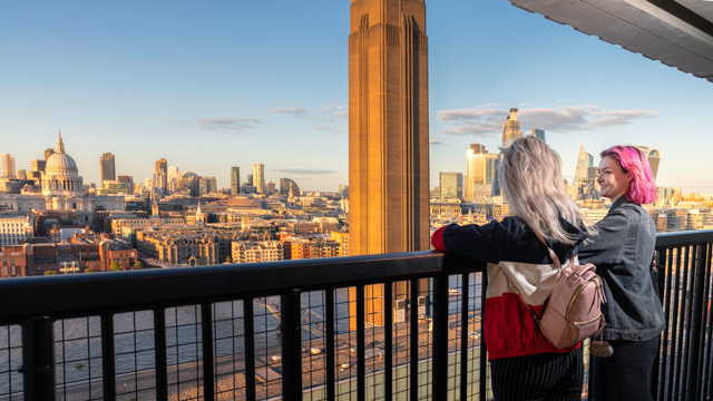Two people enjoy views across London from Tate Modern viewing platform